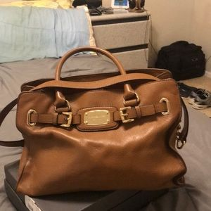 Leather purse by Michael Kors